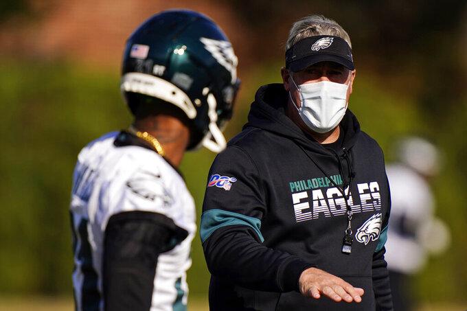 Philadelphia Eagles' Doug Pederson, right, talks with Jalen Mills during practice at the NFL football team's training facility, Thursday, Nov. 19, 2020, in Philadelphia. (AP Photo/Matt Slocum, Pool)