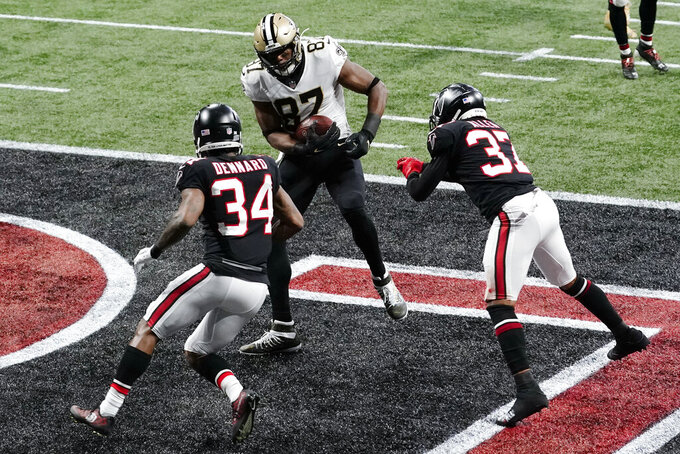 New Orleans Saints tight end Jared Cook (87) runs into the end zone for a touchdown against the Atlanta Falcons during the first half of an NFL football game, Sunday, Dec. 6, 2020, in Atlanta. (AP Photo/Brynn Anderson)