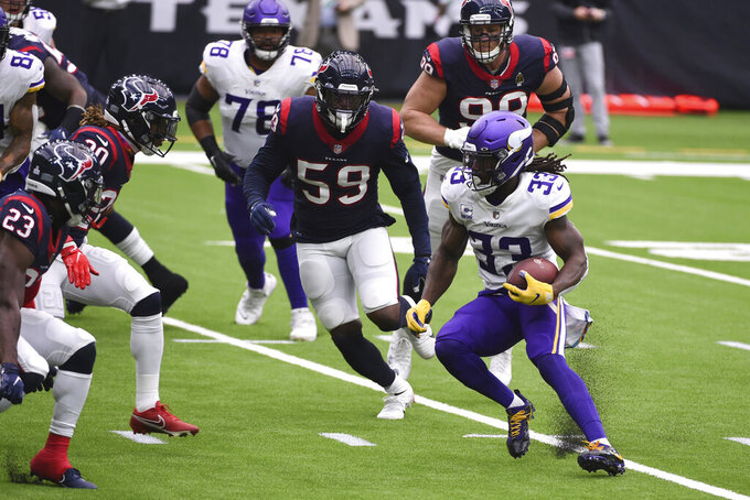 Minnesota Vikings running back Dalvin Cook (33) runs against the Houston Texans during first half of an NFL football game Sunday, Oct. 4, 2020, in Houston. (AP Photo/Eric Christian Smith)