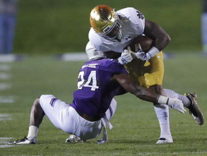 Notre Dame's Tony Jones Jr., right, is tackled by Northwestern's Montre Hartage during the first half of an NCAA college football game Saturday, Nov. 3, 2018, in Evanston, Ill. (AP Photo/Jim Young)