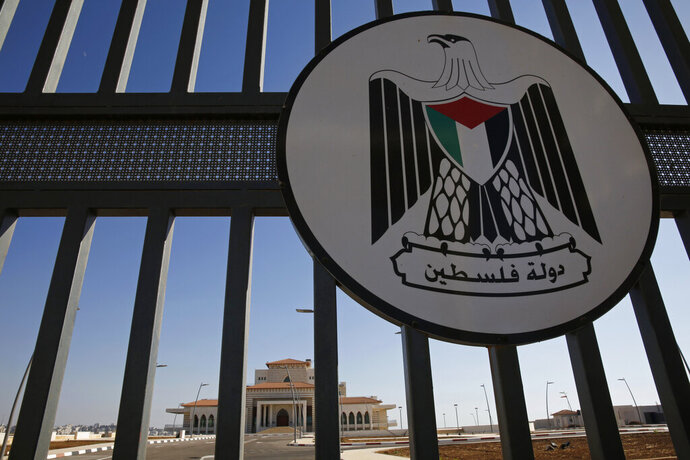 FILE - In this Monday, Aug. 28, 2017, file photo, a newly built mansion for the Palestinian Authority stands behind a gate and seal on the outskirts of the West Bank city of Ramallah. Amnesty International on Thursday, May 7, 2020, censured Palestinian authorities in the West Bank and the Gaza Strip for detaining critics and opponents for expressing their views. (AP Photo/Nasser Nasser, File)