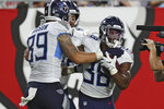 Tennessee Titans running back Mekhi Sargent (38) celebrates with tight end Tommy Hudson (89) after Sargent caught a 5-yard touchdown pass during the first half of an NFL preseason football game against the Tampa Bay Buccaneers Saturday, Aug. 21, 2021, in Tampa, Fla. (AP Photo/Mark LoMoglio)