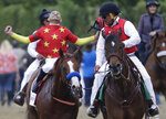 Jockey Mike Smith reacts after guiding Justify to win the 150th running of the Belmont Stakes horse race and the Triple Crown, Saturday, June 9, 2018, in Elmont, N.Y. (AP Photo/Julio Cortez)