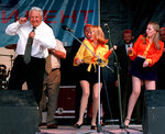 FILE - In this June 10, 1996, file photo, Russian President Boris Yeltsin dances at a rock concert after arriving in Rostov, Russia. (AP Photo/Alexander Zemlianichenko, File)