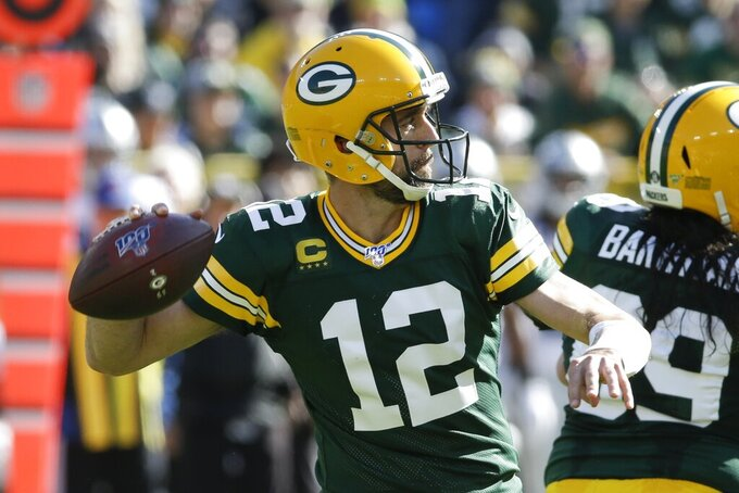 Green Bay Packers' Aaron Rodgers throws during the first half of an NFL football game against the Oakland Raiders Sunday, Oct. 20, 2019, in Green Bay, Wis. (AP Photo/Mike Roemer)