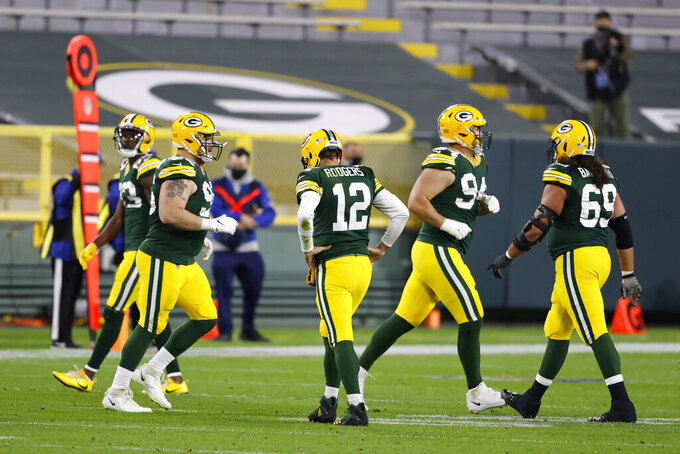 Green Bay Packers quarterback Aaron Rodgers (12) walks off the field during the second half of an NFL football game against the Atlanta Falcons, Monday, Oct. 5, 2020, in Green Bay, Wis. (AP Photo/Tom Lynn)