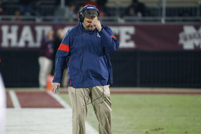 """In this Nov. 28, 2019 photograph, Mississippi head coach Matt Luke reacts to a play against Mississippi state during an NCAA college football game in Starkville, Miss. Mississippi has fired Luke, three days after his third non-winning season ended with an excruciating rivalry game loss. Athletic director Keith Carter said Sunday, Dec. 1, 2019 the decision to change coaches was made after evaluating the trajectory of the program and not seeing enough """"momentum on the field. (AP Photo/Rogelio V. Solis)"""