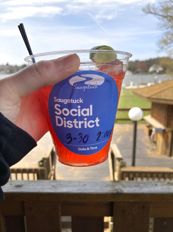 The city of Saugatuck, Mich., is piloting a social district this spring which would allow establishments with permission from the state to serve to-go alcohol inside the bounds of the social district provided the alcohol comes from approved establishments in cups marked with the social district logo, seen on March 30, 2021. (Carolyn Muyskens/The Holland Sentinel via AP)