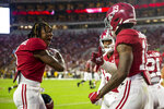 Alabama wide receiver Jameson Williams (1) celebrates with tight end Jahleel Billingsley (19) after Billingsley's touchdown against Southern Miss during the first half of an NCAA college football game, Saturday, Sept. 25, 2021, in Tuscaloosa, Ala. (AP Photo/Vasha Hunt)