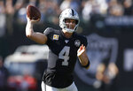 Oakland Raiders quarterback Derek Carr (4) looks to pass against the Detroit Lions during the first half of an NFL football game in Oakland, Calif., Sunday, Nov. 3, 2019. (AP Photo/D. Ross Cameron)