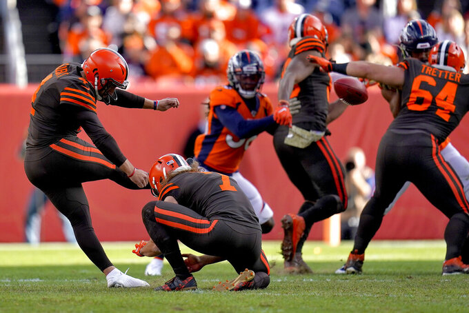 Cleveland Browns kicker Austin Seibert (4) kicks a field goal as punter Jamie Gillan (7) holds against the Denver Broncos during the first half of NFL football game, Sunday, Nov. 3, 2019, in Denver. (AP Photo/Jack Dempsey)