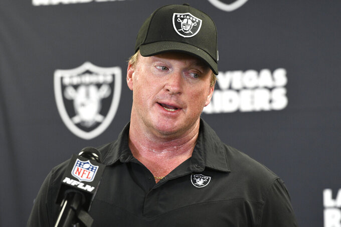 FILE - In this Sept. 19, 2021, file photo, Las Vegas Raiders head coach Jon Gruden meets with the media following an NFL football game against the Pittsburgh Steelers in Pittsburgh. Gruden is out as coach of the Raiders after emails he sent before being hired in 2018 contained racist, homophobic and misogynistic comments. A person familiar with the decision said Gruden is stepping down after The New York Times reported that Gruden frequently used misogynistic and homophobic language directed at Commissioner Roger Goodell and others in the NFL. (AP Photo/Don Wright, File)