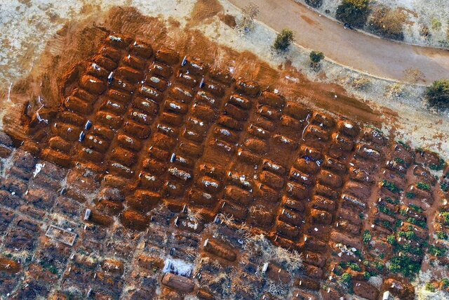 FILE - In this Aug. 5, 2020, file photo, recently filled graves are seen in the Olifantsveil Cemetery outside Johannesburg, South Africa. The worldwide death toll from the coronavirus eclipsed 1 million, nine months into a crisis that has devastated the global economy, tested world leaders' resolve, pitted science against politics and forced multitudes to change the way they live, learn and work. (AP Photo/Jerome Delay, File)