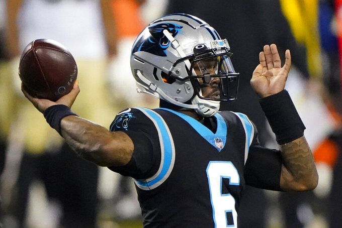 Carolina Panthers quarterback P.J. Walker passes against the New Orleans Saints during the second half of an NFL football game Sunday, Jan. 3, 2021, in Charlotte, N.C. (AP Photo/Brian Blanco)