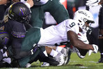 Michigan State running back Kenneth Walker III., right, is tackled by Northwestern linebacker Khalid Jones during the first half of an NCAA college football game in Evanston, Ill., Friday, Sept. 3, 2021. (AP Photo/Nam Y. Huh)