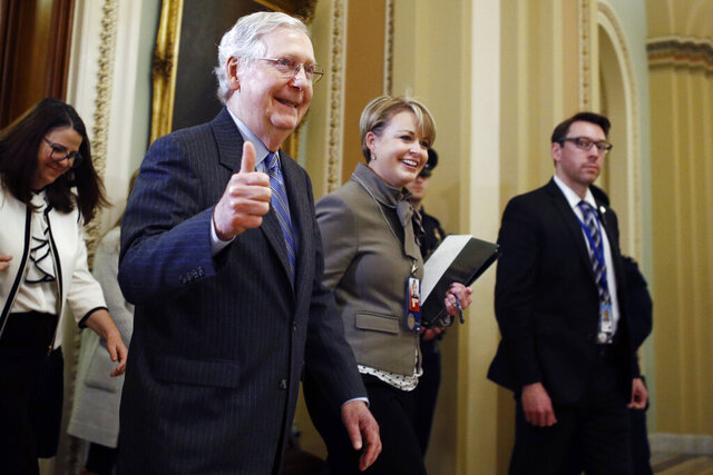 Senate Majority Leader Mitch McConnell, R-Ky., gives a thumbs-up as he leaves the Senate chamber during the impeachment trial of President Donald Trump at the Capitol, Friday, Jan. 31, 2020, in Washington. (AP Photo/Steve Helber)