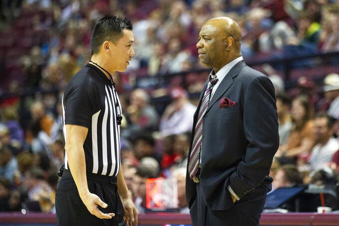The referee talks to Florida State head coach Leonard Hamilton in the second half of an NCAA college basketball game against North Alabama in Tallahassee, Fla., Saturday, Dec. 28, 2019. (AP Photo/Mark Wallheiser)