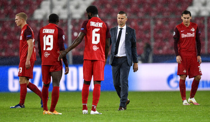 Salzburg's head coach Jesse Marsch walks to his disappointed players after the Champions League group A soccer match between RB Salzburg and Bayern Munich in Salzburg, Austria, Tuesday, Nov. 3, 2020. (AP Photo/Andreas Schaad)