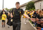 Missouri quarterback Drew Lock is greeted by fans as he walks into Memorial Stadium before an NCAA college football game against Wyoming, Saturday, Sept. 8, 2018, in Columbia, Mo. (AP Photo/L.G. Patterson)