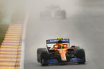 Mclaren driver Lando Norris of Britain steers his car during qualification ahead of the Formula One Grand Prix at the Spa-Francorchamps racetrack in Spa, Belgium, Saturday, Aug. 28, 2021. The Belgian Formula One Grand Prix will take place on Sunday. (AP Photo/Francisco Seco)