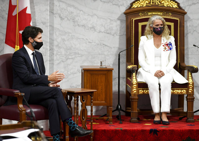 Canadian Prime Minister Justin Trudeau waits for Gov. Gen. Julie Payette to deliver the throne speech in the Senate chamber in Ottawa, Ontario, on Wednesday, Sept. 23, 2020. (Adrian Wyld/The Canadian Press via AP)