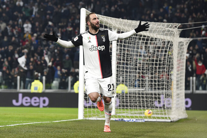 Juventus' Gonzalo Higuain celebrates after scoring during the Italian Cup soccer match between Juventus and Udinese, at the Allianz Stadium in Turin, Italy, Wednesday, Jan. 15, 2020. (Fabio Ferrari/LaPress via AP)