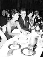 FILE - In this March 11, 1946 file photo, at a crowded table at Ciro's, Frank Sinatra steals a glance at his Oscar which he won for his performance in the film