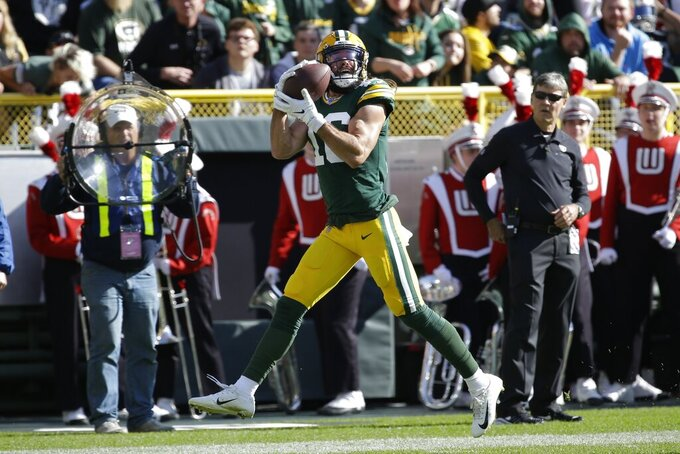 Green Bay Packers' Jake Kumerow catches a touchdown pass during the first half of an NFL football game against the Oakland Raiders Sunday, Oct. 20, 2019, in Green Bay, Wis. (AP Photo/Mike Roemer)