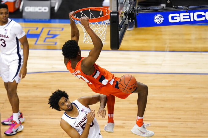 Syracuse forward Robert Braswell (20) dunks over Virginia guard Tomas Woldetensae (53) during the first half of an NCAA college basketball game in the quarterfinal round of the Atlantic Coast Conference tournament in Greensboro, N.C., Thursday, March 11, 2021. (AP Photo/Gerry Broome)