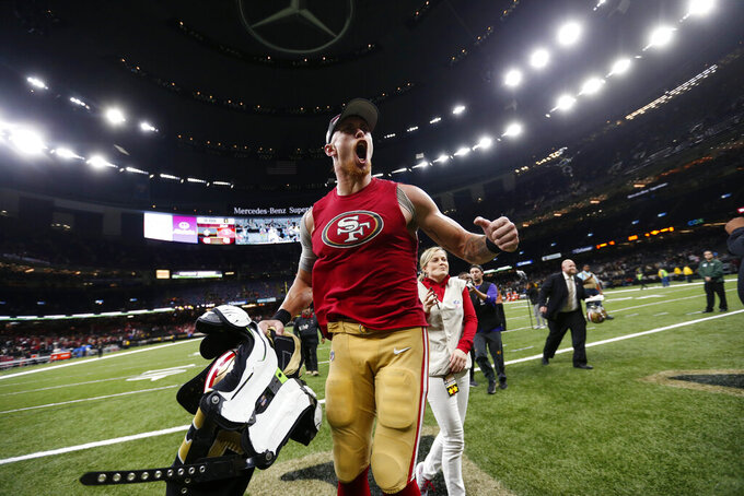 San Francisco 49ers tight end George Kittle celebrates after defeating the New Orleans Saints on a last second field goal, which was set up by his pass reception, after an NFL football game in New Orleans, Sunday, Dec. 8, 2019. The 49ers won 48-46. (AP Photo/Butch Dill)