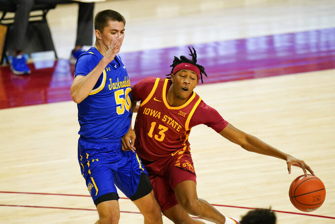 Iowa State forward Javan Johnson (13) drives past South Dakota State guard David Wingett during the first half of an NCAA college basketball game, Wednesday, Dec. 2, 2020, in Ames, Iowa. (AP Photo/Charlie Neibergall)