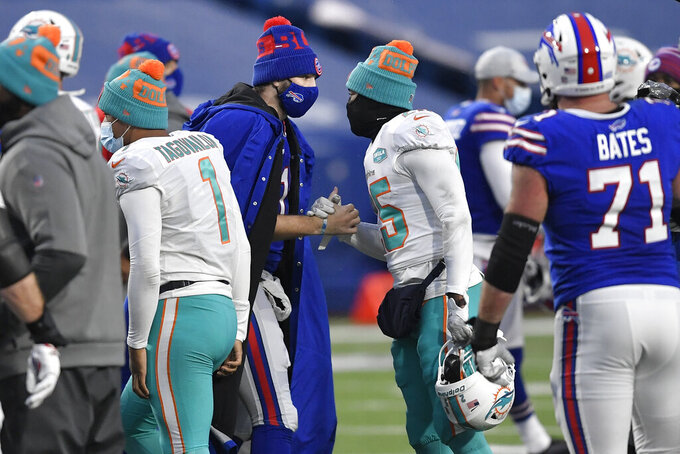 Buffalo Bills quarterback Josh Allen, center left, and Buffalo Bills running back Taiwan Jones, center right, meet on the field after an NFL football game, Sunday, Jan. 3, 2021, in Orchard Park, N.Y. (AP Photo/Adrian Kraus)