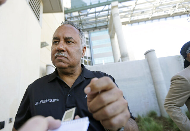 FILE - In this Sept. 14, 2015, file photo, Marlin Gusman, sheriff of New Orleans, speaks outside a new jail facility in New Orleans as buses transferring inmates from the old jail arrive. Gusman can be put back in control of the city's notoriously troubled jail despite still-serious problems that triggered a 2012 lawsuit and U.S. Justice Department oversight, a federal judge ruled Wednesday, Aug. 5, 2020. (AP Photo/Gerald Herbert, File)