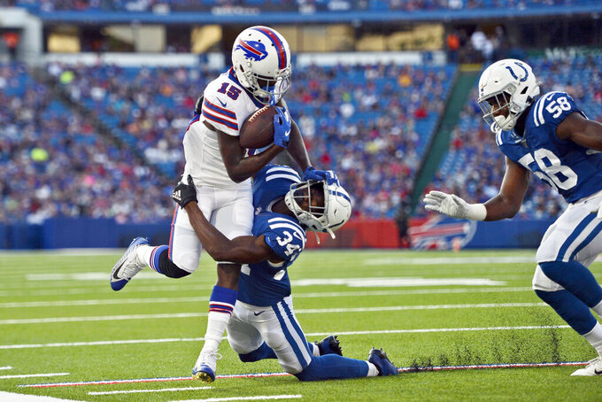 Indianapolis Colts' Rock Ya-Sin (34), center, tries to bring down Buffalo Bills' John Brown during the first half of an NFL preseason football game, Thursday, Aug. 8, 2019, in Orchard Park, N.Y. (AP Photo/Adrian Kraus)