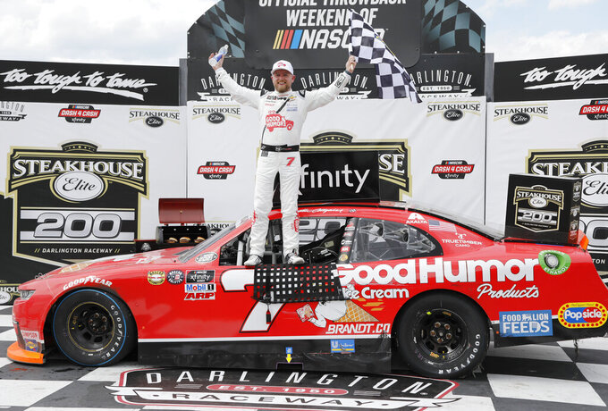 Justin Allgaier celebrates in Victory Lane after winning the NASCAR Xfinity Series auto race at Darlington Raceway, Saturday, May 8, 2021, in Darlington, S.C. (AP Photo/Terry Renna)
