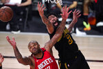 Los Angeles Lakers' Anthony Davis (3) and Houston Rockets' P.J. Tucker (17) battle for a rebound during the second half of an NBA conference semifinal playoff basketball game Sunday, Sept. 6, 2020, in Lake Buena Vista, Fla. (AP Photo/Mark J. Terrill)