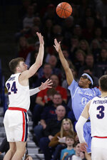 Gonzaga forward Corey Kispert (24) shoots over San Diego guard Marion Humphrey (0) during the first half of an NCAA college basketball game in Spokane, Wash., Thursday, Feb. 27, 2020. (AP Photo/Young Kwak)