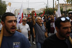 Protesters from Communist-affiliated PAME labor union hold flags and shout slogans during a 24-hour strike in central Athens, Tuesday, Sept. 24, 2019. Greek island ferries were moored in port, many Athens public transport services were shut down and state hospitals functioned on emergency staffing due to Tuesday's strike by Greek unions against draft legislation that would make it harder for unions to call strikes in the future. (AP Photo/Petros Giannakouris)