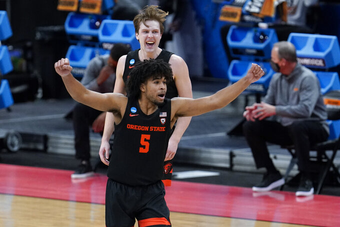 Oregon State guard Ethan Thompson (5) reacts to a basket against Tennessee during the second half of a men's college basketball game in the first round of the NCAA tournament at Bankers Life Fieldhouse in Indianapolis, Friday, March 19, 2021. (AP Photo/Paul Sancya)