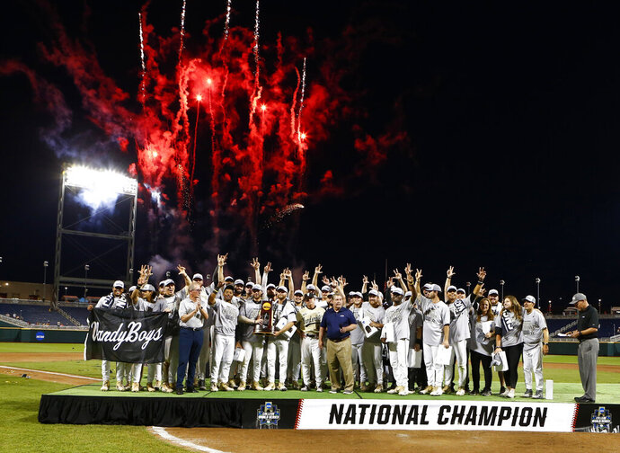 FILE - In a Wednesday, June 26, 2019 file photo, Vanderbilt players and coaches celebrate with the trophy after Vanderbilt defeated Michigan to win Game 3 of the NCAA College World Series baseball finals in Omaha, Neb. For the first time in seven decades, there is no college baseball in Omaha this summer. The eight-team College World Series would have started with opening-round games next weekend. The event has been a summer staple in Omaha since 1950. (AP Photo/John Peterson, File)