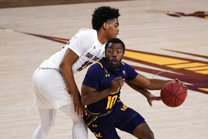 California guard Makale Foreman (10) drives by Arizona State guard Josh Christopher, who tries to knock the ball away during the second half of an NCAA college basketball game Thursday, Jan. 28, 2021, in Tempe, Ariz. Arizona State won 72-68. (AP Photo/Rick Scuteri)