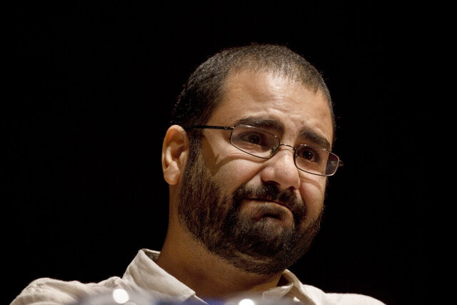 FILE - In this Sept. 22, 2014, file photo, Egypt's leading pro-democracy activist Alaa Abdel-Fattah takes a moment as he speaks about his late father Ahmed Seif, one of Egypt's most respected human rights lawyers, during a conference held at the American University in Cairo, Egypt. An Egyptian court has overturned a decision to release Abdel-Fattah who has been detained for nearly five months without trial. He was arrested in September amid an unprecedented crackdown that followed small protests demanding President Abdel Fattah el-Sissi step down. On Wednesday, Feb. 19, 2020, a court had ordered that Abdel Fattah be released but shortly afterward the State Security Prosecutors appealed the decision before another court. (AP Photo/Nariman El-Mofty, File)