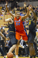 Florida's Kerry Blackshear Jr., center, has the ball knocked away as he drives between Missouri's Kobe Brown, right, and Reed Nikko, left, during the first half of an NCAA college basketball game Saturday, Jan. 11, 2020, in Columbia, Mo. (AP Photo/L.G. Patterson)