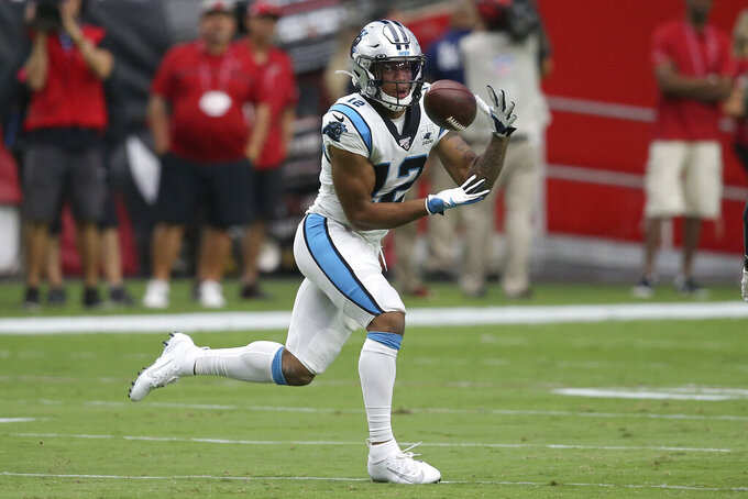 Carolina Panthers wide receiver D.J. Moore (12) pulls in a touchdown catch against the Arizona Cardinals during the first half of an NFL football game, Sunday, Sept. 22, 2019, in Glendale, Ariz. (AP Photo/Ross D. Franklin)