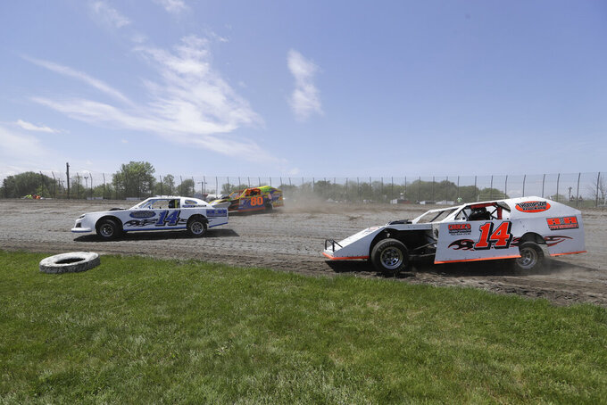 Drivers steers the cars out of turn four during a practice session at Gas City I-69 Speedway, Sunday, May 24, 2020, in Gas City, Ind. (AP Photo/Darron Cummings)