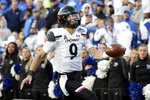 Cincinnati quarterback Desmond Ridder scores a touchdown on a 15-yard run against Memphis during the first half of an NCAA college football game for the American Athletic Conference championship Saturday, Dec. 7, 2019, in Memphis, Tenn. (AP Photo/Mark Humphrey)