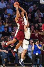 Florida State guard Anthony Polite (13) rebounds a ball over Georgia Tech guard Jose Alvarado (10) during the first half of an NCAA college basketball game Saturday, Feb. 16, 2019, in Atlanta. (AP Photo/Danny Karnik)