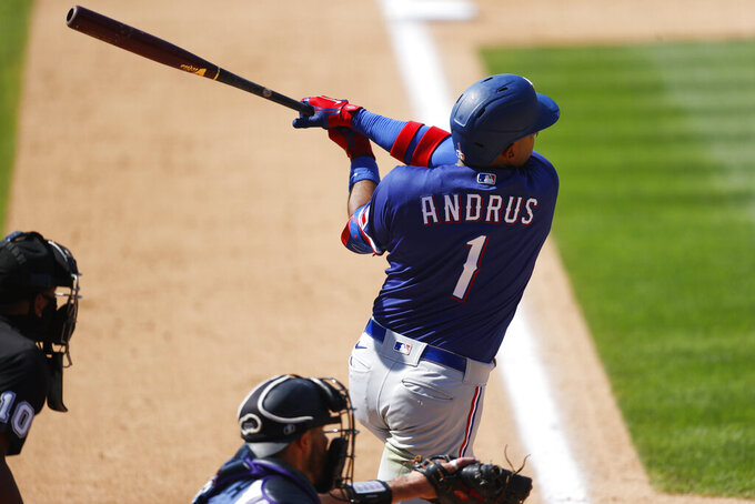 Texas Rangers' Elvis Andrus connects for a double off Colorado Rockies relief pitcher Daniel Bard in the eighth inning of a baseball game Sunday, Aug. 16, 2020, in Denver. (AP Photo/David Zalubowski)