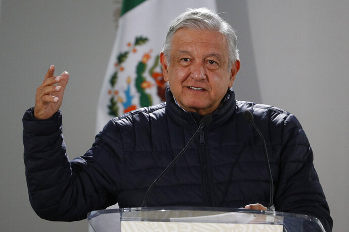 FILE - In this April 3, 2020 file photo, Mexican President Andres Manuel Lopez Obrador speaks after visiting facilities at a Mexican Social Security Institute hospital that will be converted to receive patients suffering from Covid-19, in the Coyoacan district of Mexico City. Lopez Obrador said that sections of 80 public hospitals were being isolated and prepared with an average of eight beds and respirators to care for an expected influx of patients with the new coronavirus. (AP Photo/Rebecca Blackwell, File)