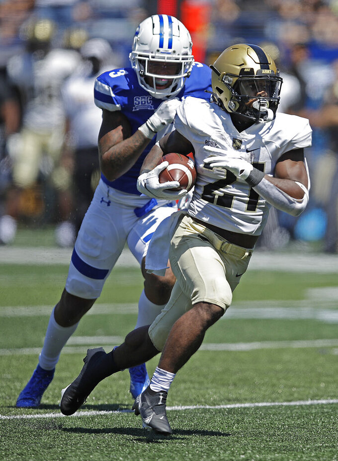 Army running back Tyrell Robinson, right, outruns Georgia State safety Chris Bacon (3) for a touchdown in the third quarter of an NCAA football game Saturday, Sept. 4, 2021, in Atlanta. (AP Photo/Ben Margot)